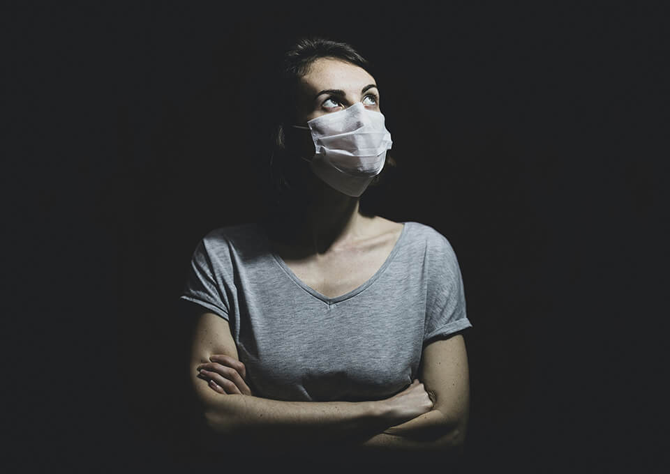 A woman with a mask on a black background